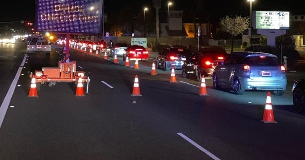 DUI checkpoint by police during traffic.