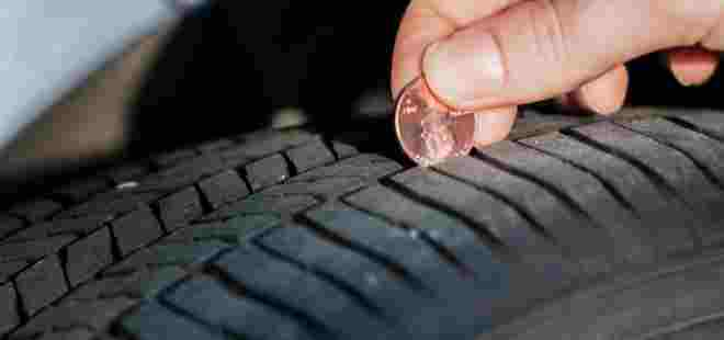 Checking tire tread on your vehicle.
